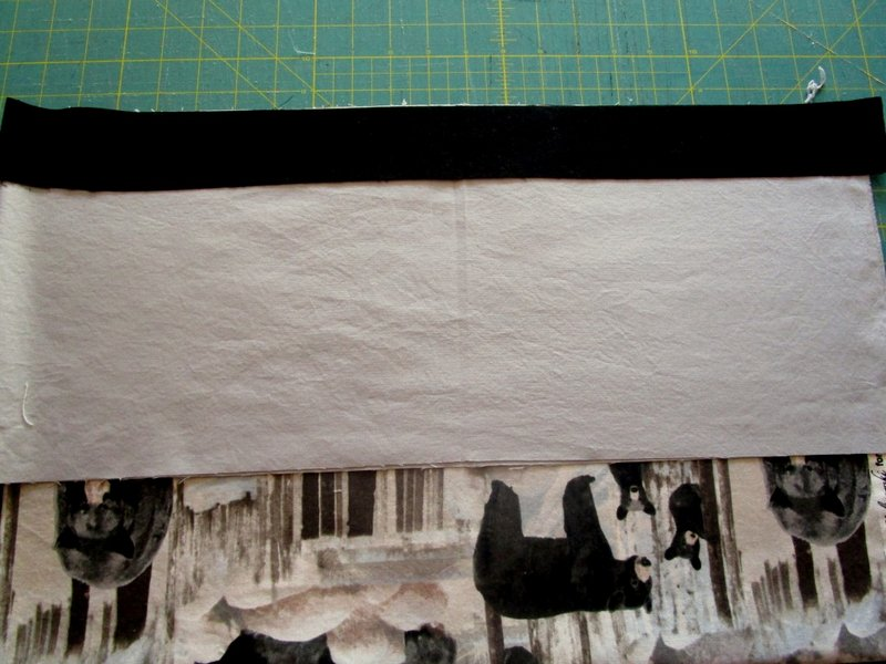 6 Lay the three pieces together making sure to align the folds and the raw edges