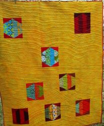 Quilt back with scattered hexagons