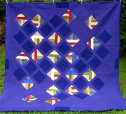 Large diagonal half square triangle quilt