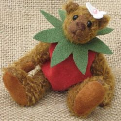 Mohair bear wearing a strawberry costume